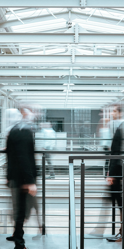 Blurred corporate employees in business company
